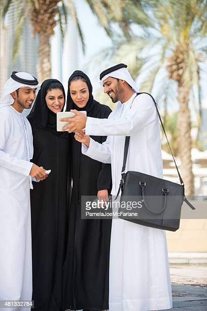 Business Meeting, Middle Eastern Men and Women Reviewing Computer Tablet
