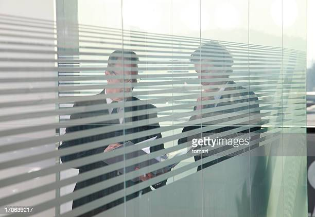 Business meeting through glass
