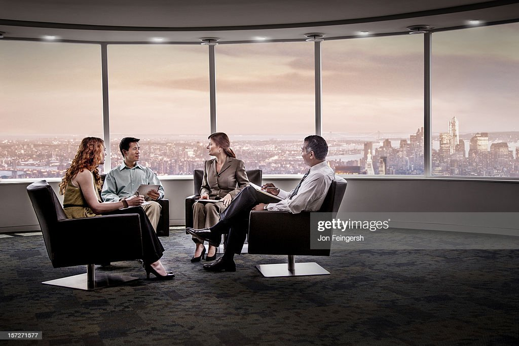 Business meeting with cityscape behind : Stock Photo