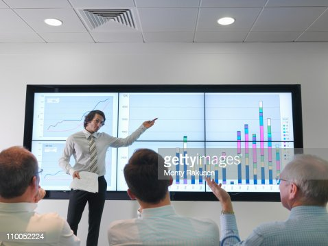 Business meeting with graphs on screen : Stock Photo
