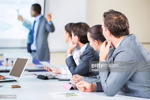 Business meeting.....black lecturer using digital projector,home made slide