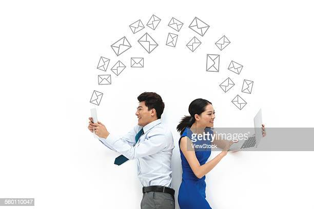 Business men and women use computer communication