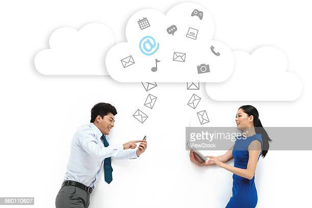 Business men and women with electronic communication products