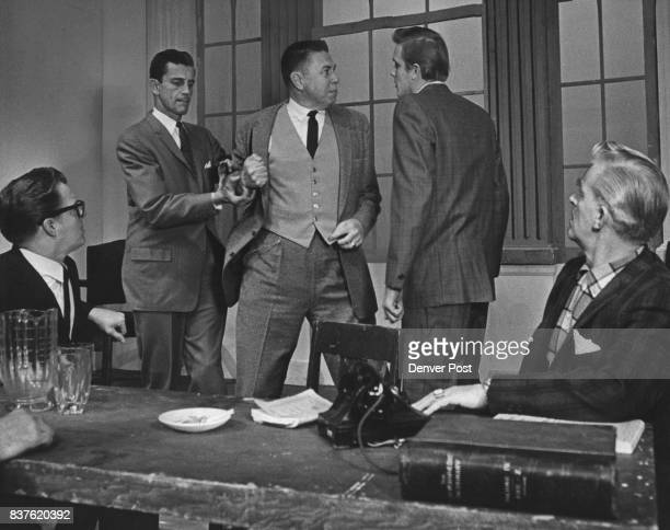 Business men argue over the owneship of a corporation in 'Calculated Risk' coming to the bonfils Theater on Dec 3 left to right standing are Robert...