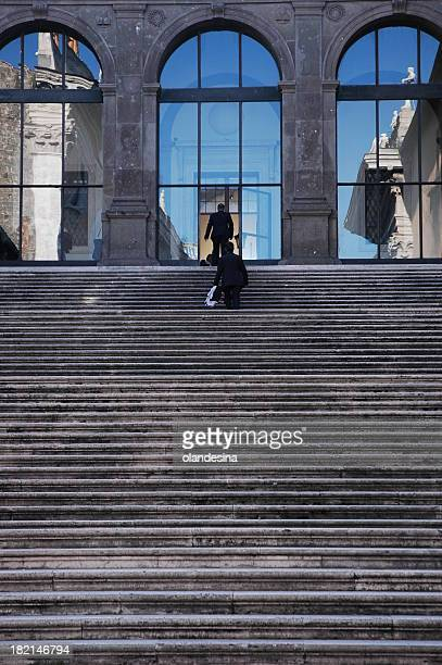 Business men going up stairs of architectural italian building