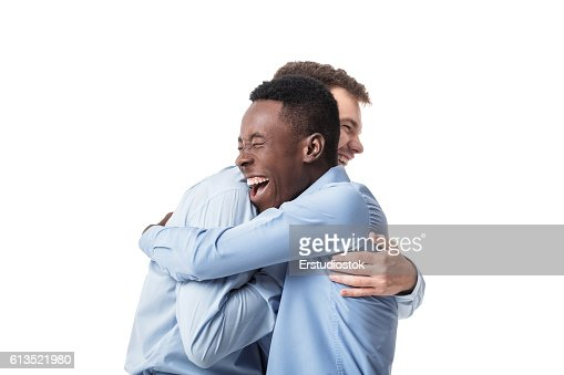 business men happy embracing : Stock Photo