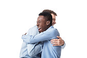 successful business men happy embracing isolated on white background. meeting friends