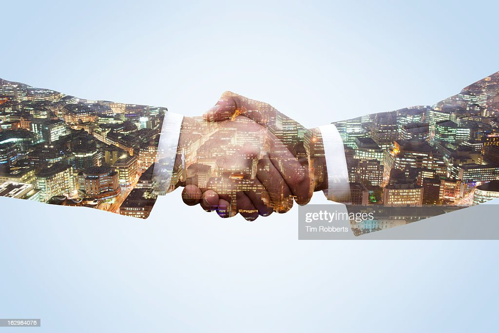 Business men shaking hands with city view at night : Stock Photo