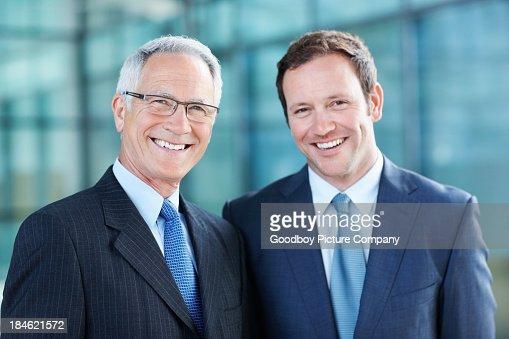 Business men smiling
