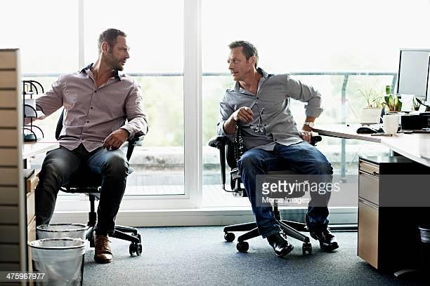 Business men talking in modern office