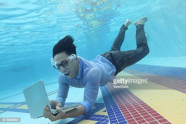 Business men use computers under water
