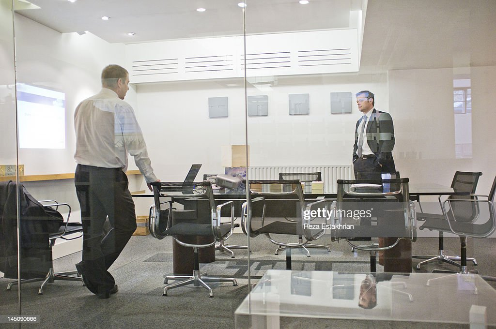Business men waiting for meeting to start : Stock Photo
