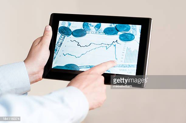 Business news on the screen of tablet computer