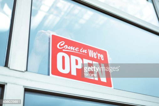 Business Opening with 'Open' Sign Hz
