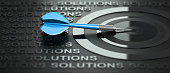 3D illustration of a dartboard and one blue dart over black background with the word solutions written many times and surrounding the target. Consulting or advice concept.
