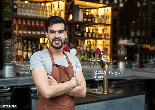 Business owner at a restaurant looking happy