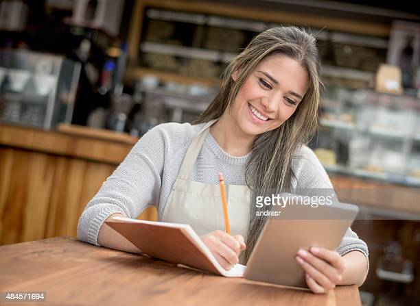 Business owner doing the books at a cafe
