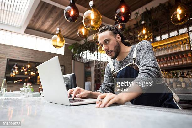 Business owner doing the books at a restaurant