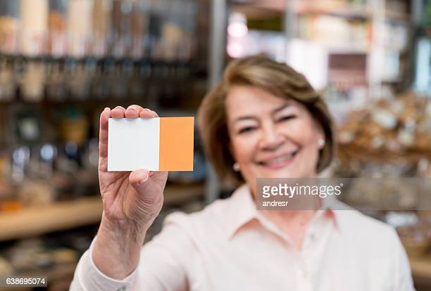 Business owner holding a business card