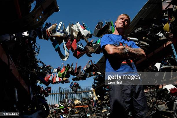 Business owner Shaun Krugel poses for a photograph between stacks of used engine components at 'The Bike Hospital' on October 18 2017 in Johannesburg...