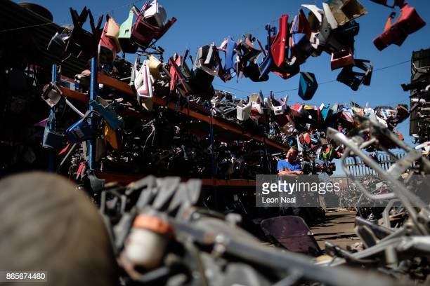 Business owner Shaun Krugel poses for photographs between stacks of used engine components at 'The Bike Hospital' on October 18 2017 in Johannesburg...