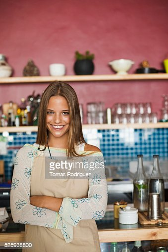 Business owner standing in cafe : Bildbanksbilder