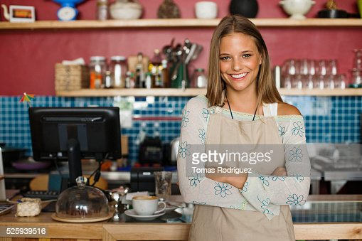 Business owner standing in cafe : Stock-Foto
