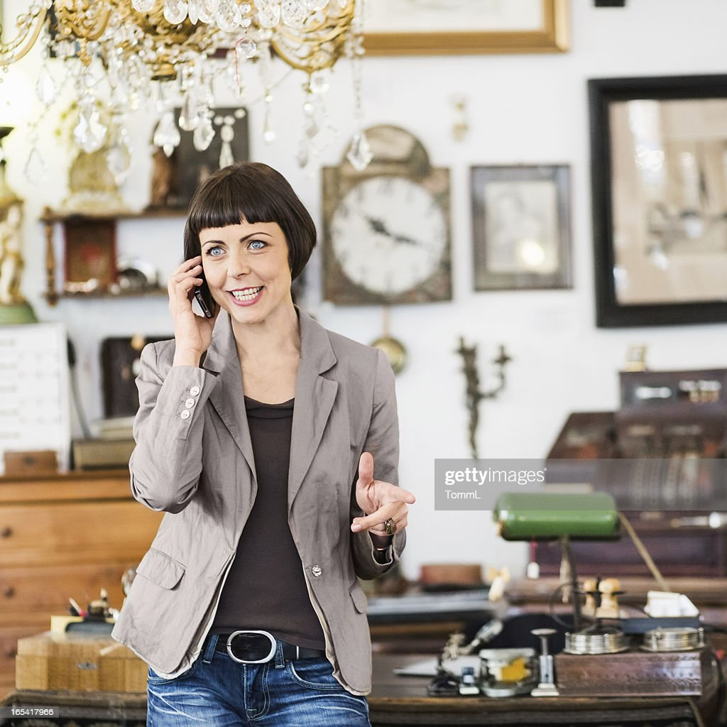 Business Owner Using Smart Phone : Stock Photo