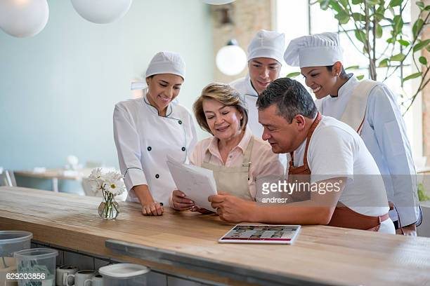 Business owner working at a restaurant with a group