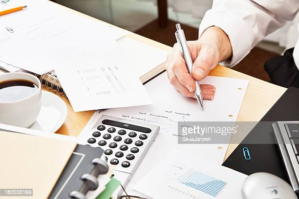 business paperwork planning calculation messy desk