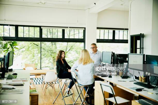 Business partners having planning meeting in high tech start up office