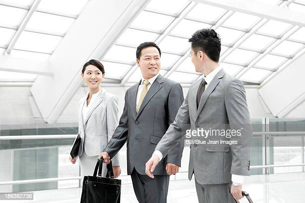 Business partners on the move in airport lobby