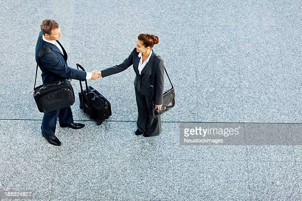 Business Partners Shaking Hands At Airport