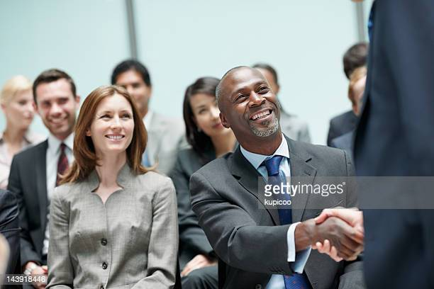 Business partners shaking hands during conference