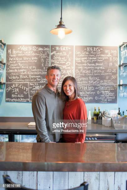 Business partners smiling in wine bar