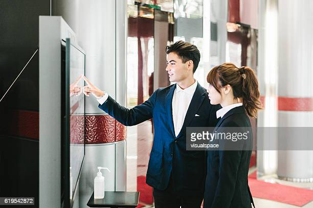 Business Partners Using an Interactive Display