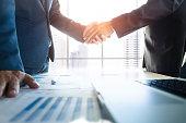 Business partnership meeting concept. Image businessmans handshake. Successful businessmen handshaking after good deal.