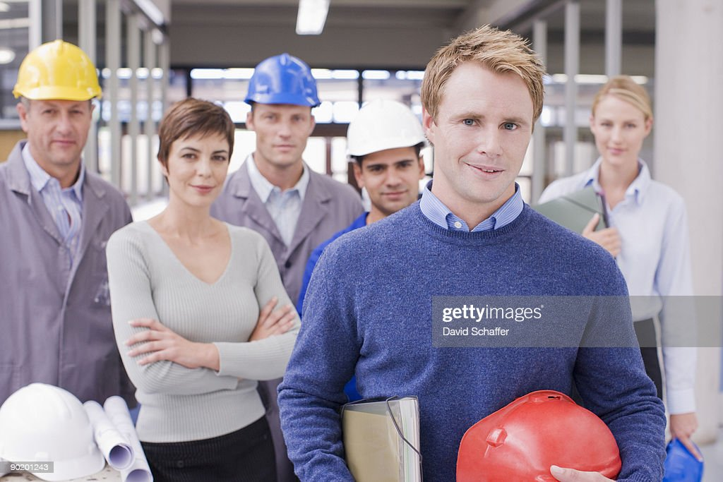 Business people and construction workers posing : Stock Photo