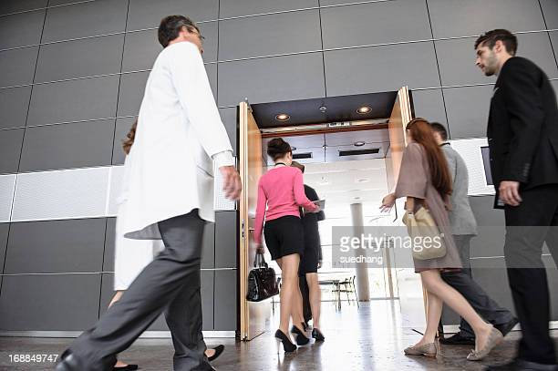 Business people and doctors in office