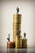 Business people and euro coin piles. Macro photo