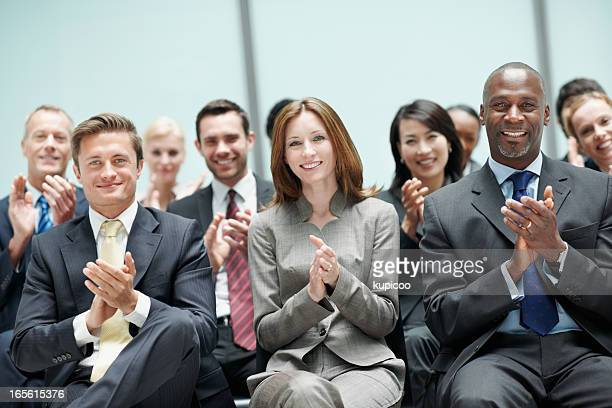 Business people applauding during presentation