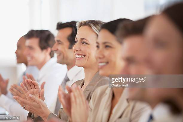 Business people applauding for presentation