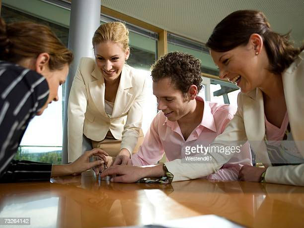 Business people assembling magnetic balls