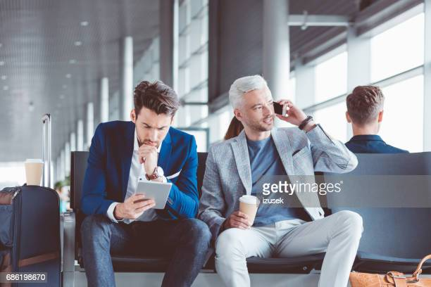 Business people at airport lounge waiting for flight