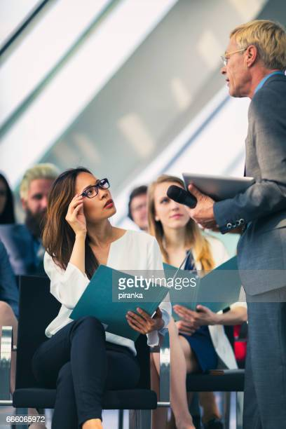 Business people attending a presentation