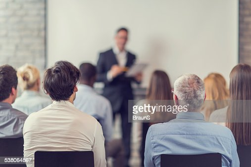 Business people attending a seminar.