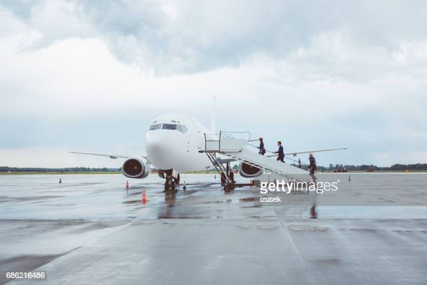 Business people boarding airplane