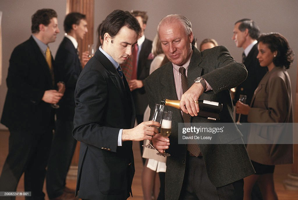 Business people celebrating with champagne : Stock Photo