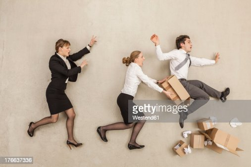 Business people chasing in office