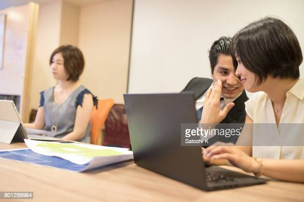 Business people chatting during meeting